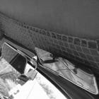 Filet porte-paquets de toit gris (au-dessus des places avant)